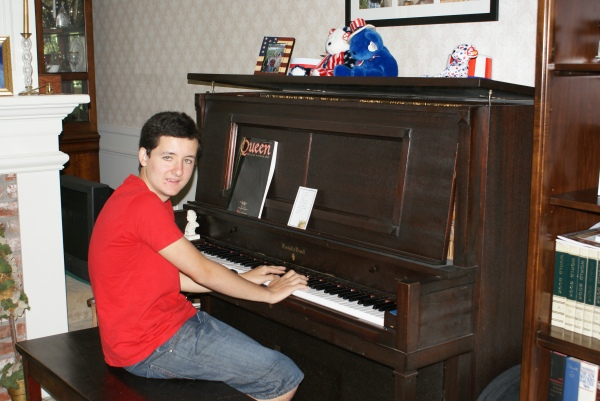 Pedro at the Nelson family piano, July 2010