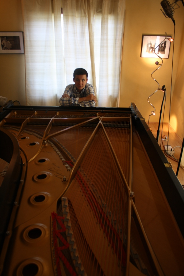 Pedro rests at the 9-foot Steinway, The Piano Studio, Seattle, July 2011.