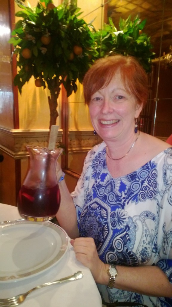 Standing out with my red hair and enjoying the laid back lifestyle Spanish style (with Sangria).