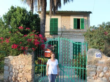 Rosa, outside the summer home in Soller, Mallorca, Spain--for 3 generations.