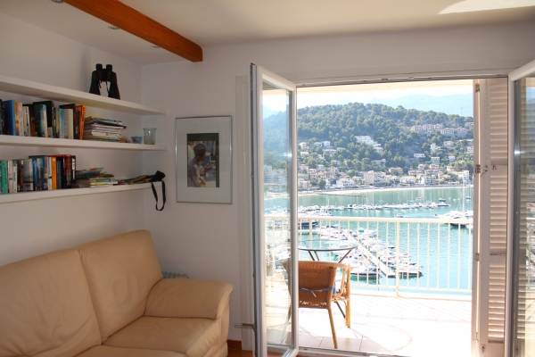 One copy of my book graces the book shelves at my apartment in the Port of Soller, with the best reading view of the Mediterranean, August 2013.