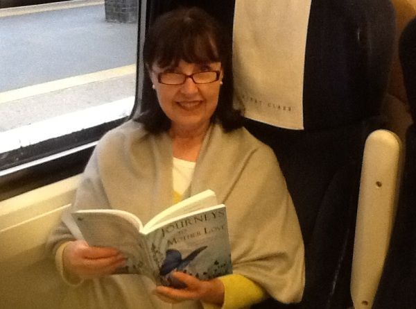 "A friend reading ""Journeys to Mother Love"" while traveling in England, October 2012."