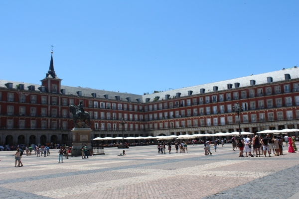 Plaza Mayor, Madrid, a popular tourist attraction, but few realize that heretics were burned at the stake here during the Spanish Inquisition.