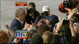 Coach Pete Carroll greets fans in Seattle.