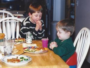 My sons praying at dinner, January 2000.