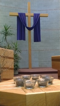 Cups of ash at the altar.