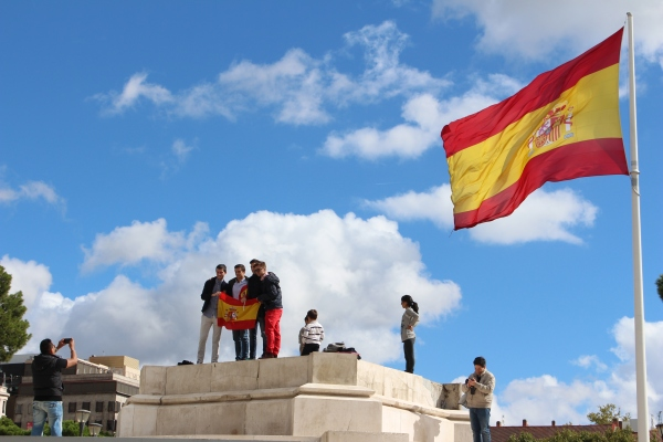Spaniards proudly display their flag at Columbus Square in Madrid, October 12, 2014.