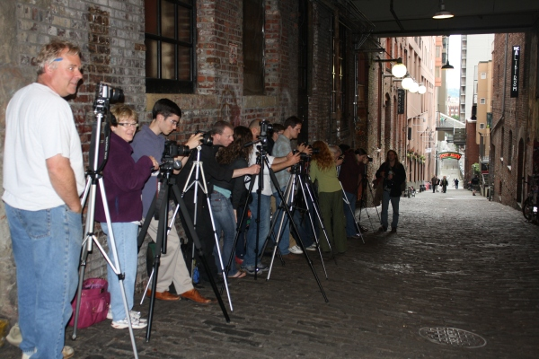 Photography students near the gum wall.
