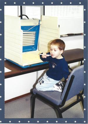 My son pondering his vote, November 2000.